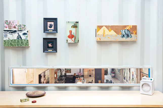 The office space has a rectangular cut-out that offers a birdseye view of the kitchen below. In the context of the surrounding small-scale paintings, at first glance the view resembles an artwork itself.<br /><br /><p><em><strong>Don't miss a word of Dwel
