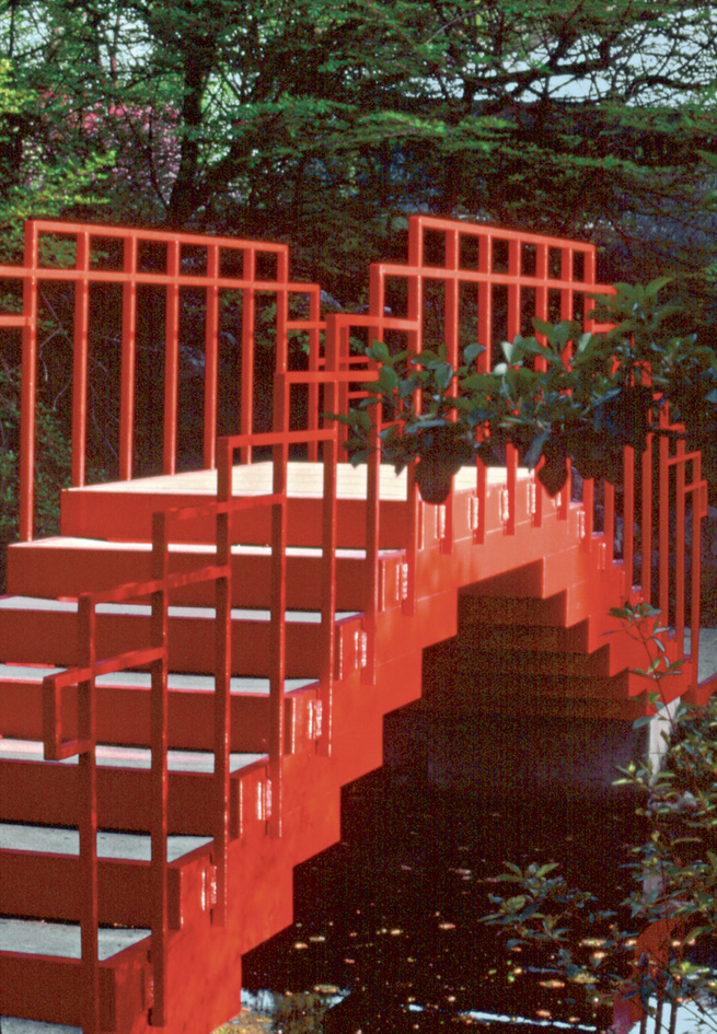 The red Lower Pond Bridge at the Dow Gardens.