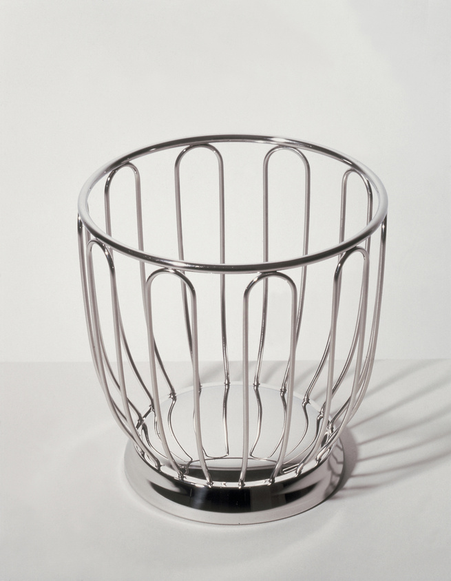 The stainless-steel Fruit Bowl 370, produced in 1952 by the Ufficio Tecnico Alessi, the company's design hub. The bowl is still in production today, and its inclusion in the exhibition suggests a relationship between the bowl's earlier, mid-century lines