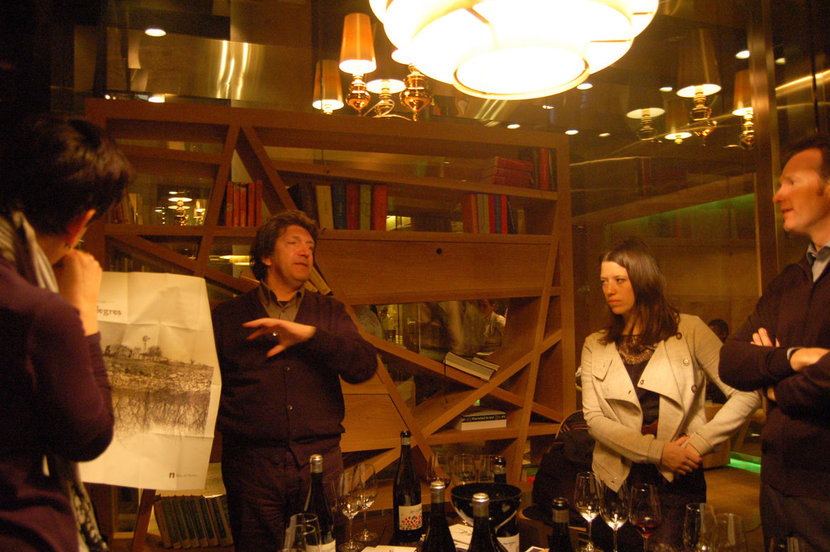 """Next we headed to a private tasting room at the wine bar <a href=""""http://www.monvinic.com/"""">Monvinic</a>, where architect Alfredo Arribas (at left, showing a drawing that he created with artist Gregori Saavedra) held court. Arribas uncorked several wines"""