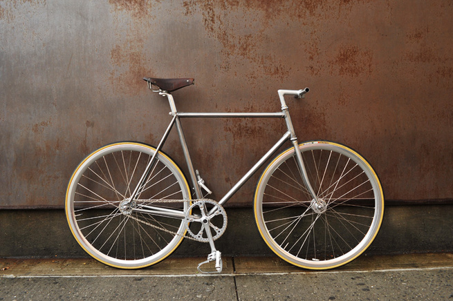 """From Bertelli's site: """"Hand brushed lugged steel. Deep rims on hig-flange hubs. Nitto bars and stem. Rare Ideale 87 leather saddle. The crankset is a vintage combo: Campagnolo Record cranks and Sugino Mighty chainring. To complete the setup we chose Velof"""