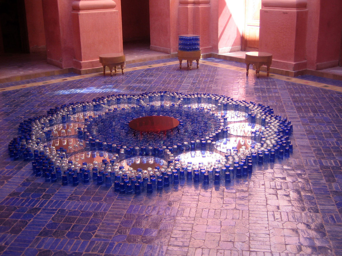 Just off the entryway was this courtyard stacked with traditional Moroccan glasses. On the stunning tiles we get an abstraction of a tea service—the elevation of a common ritual.