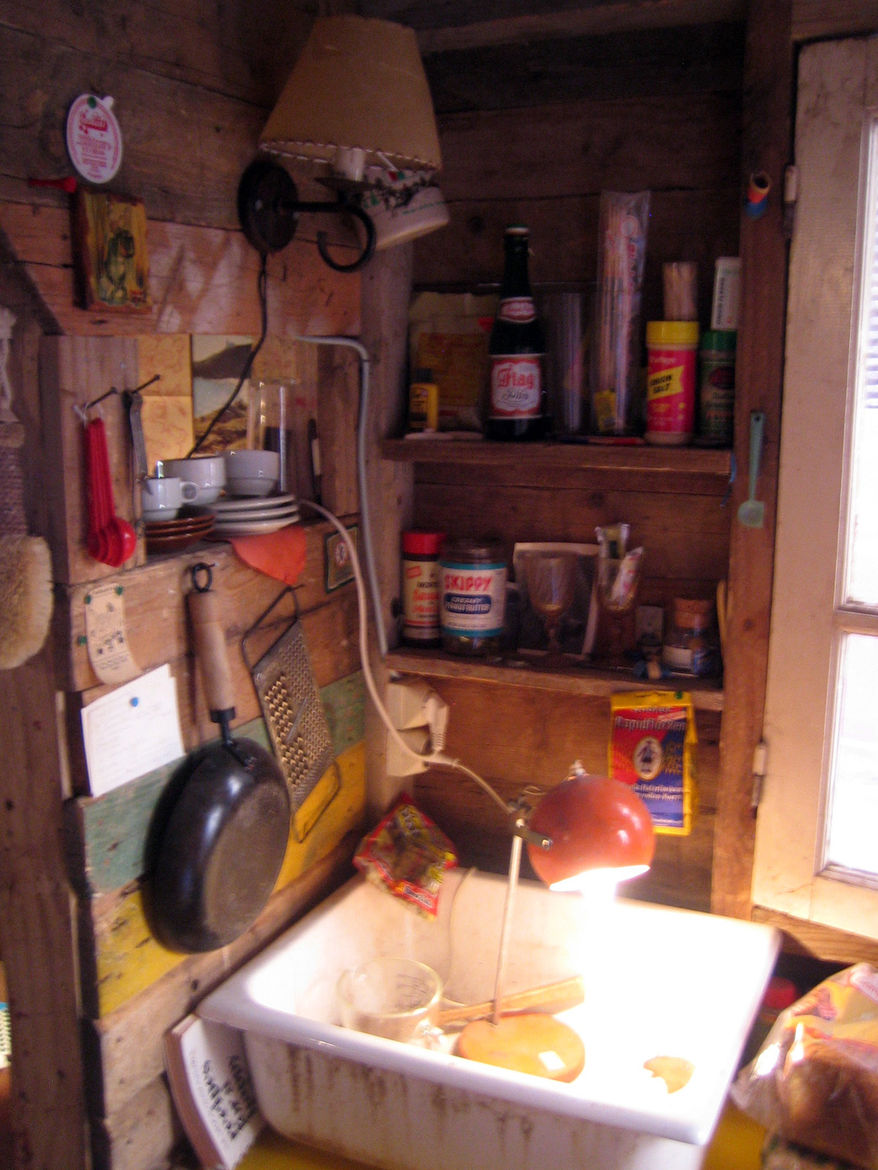 Here's the inside of the Ethan Hayes-Chute's New England shack, dirty dishes and all.