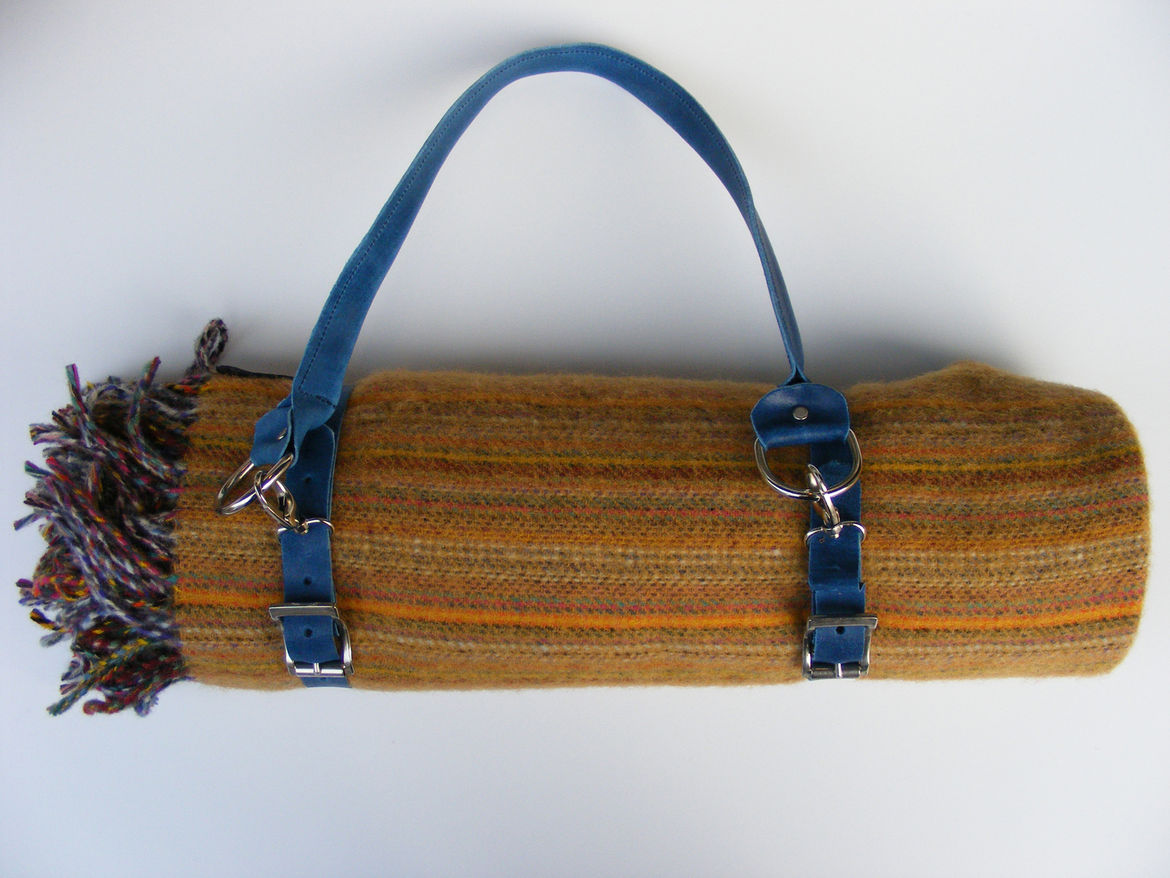 """Picnic Blanket. """"I like this handwoven picnic blanket (with a wax cloth sheet!) from England because it's made by a small company  in a small town. They don´t always answer the phone or emails, so I always imagine them out drinking tea in their garden."""""""