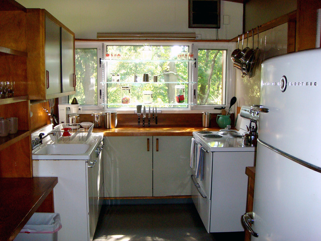 """The kitchen is one of the most unified spaces in the house, thanks to the appliances. """"Within a week of each other, we found the 1949 GE stove on E-Bay that matched the fridge,"""" says Miller. """"They were the same model of appliances that were used in the ex"""