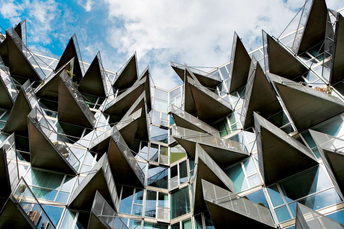 The 2005 VM apartment complex in the Ørestad district, designed by PLOT, takes its name from the shapes of the two plans: While the M balconies are flush with the building's facades, those covering the V structure jut ominously like shark's teeth.