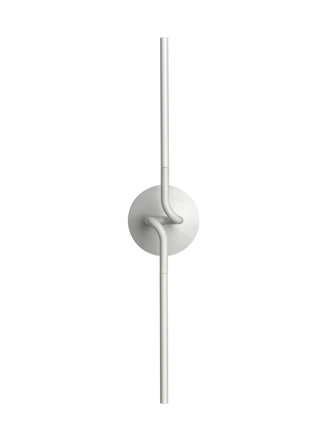 Light Spring forms part of a series of wall lamps by Flos which feature a very simple and linear design and a die-cast, painted tubular aluminum body.