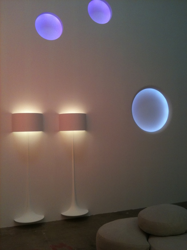 Two of Sebastian Wrong's Spun Lights hover over the floor, beneath three glowing Circle Lights.