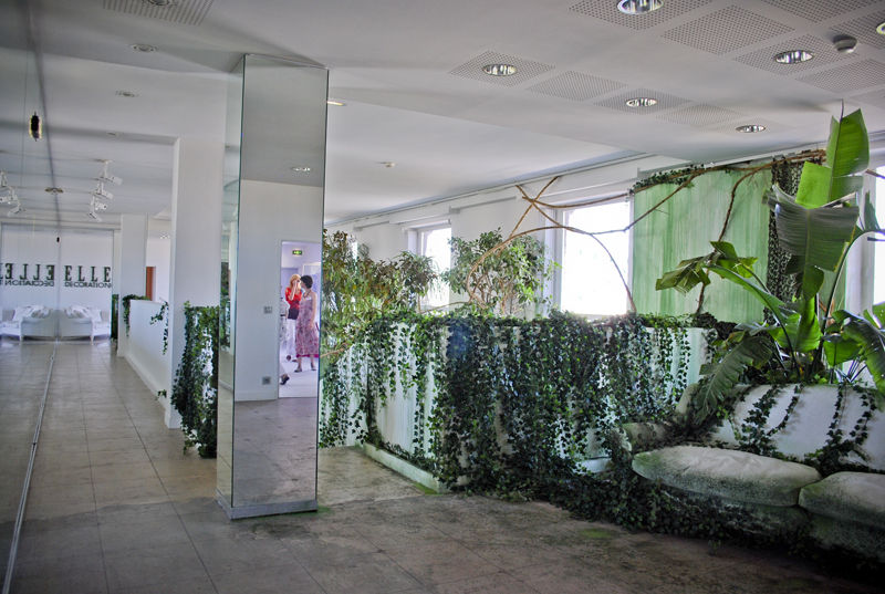 Gaultier likens Paris to a jungle in the second room—with an overwhelming amount of ivy, lichen, and other greenery invading all crevices between mirrored structures and furniture.