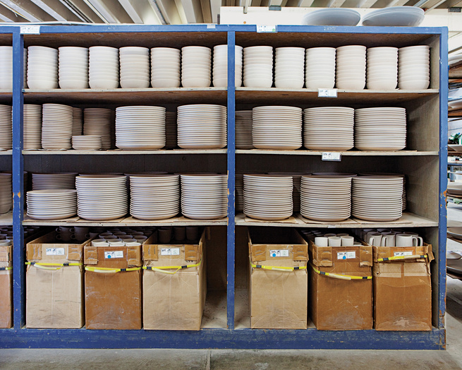Stacks of unglazed dishware line the shelves at the Heath factory in Sausalito.