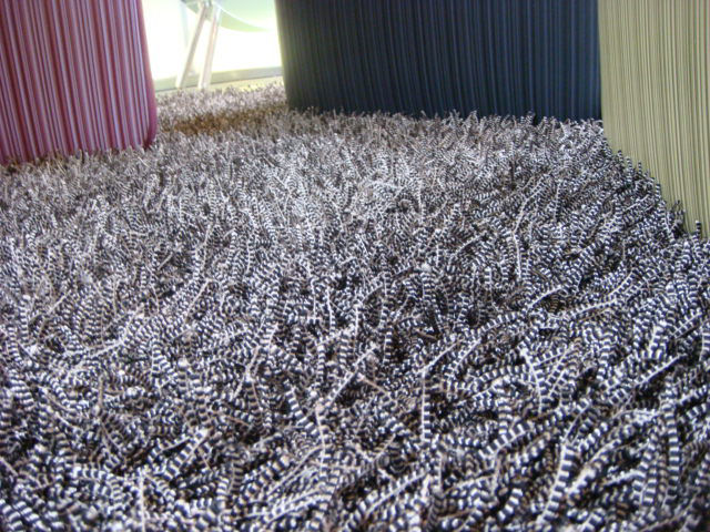 """Another """"deceptive"""" design is this Karim Rashid carpet that looks like a sea of thousands of metal springs (it's actually quite soft)."""