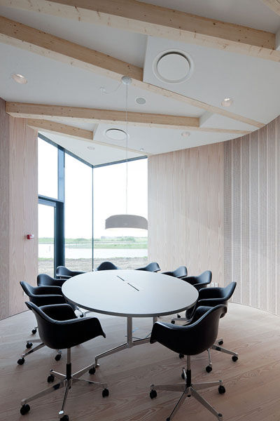 Each meeting room has a floor plan in the shape of a cow's ear or leaf, all of them slightly different in shape, size and material.