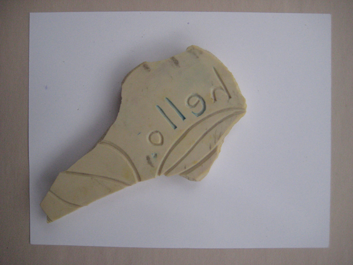Place the stamp on the paper (you can see a previously failed attempt on the reverse of my cone here). I tap the back a bit all over, just to make sure all the surface has touched, then carefully lift it off without rubbing it around across the card.