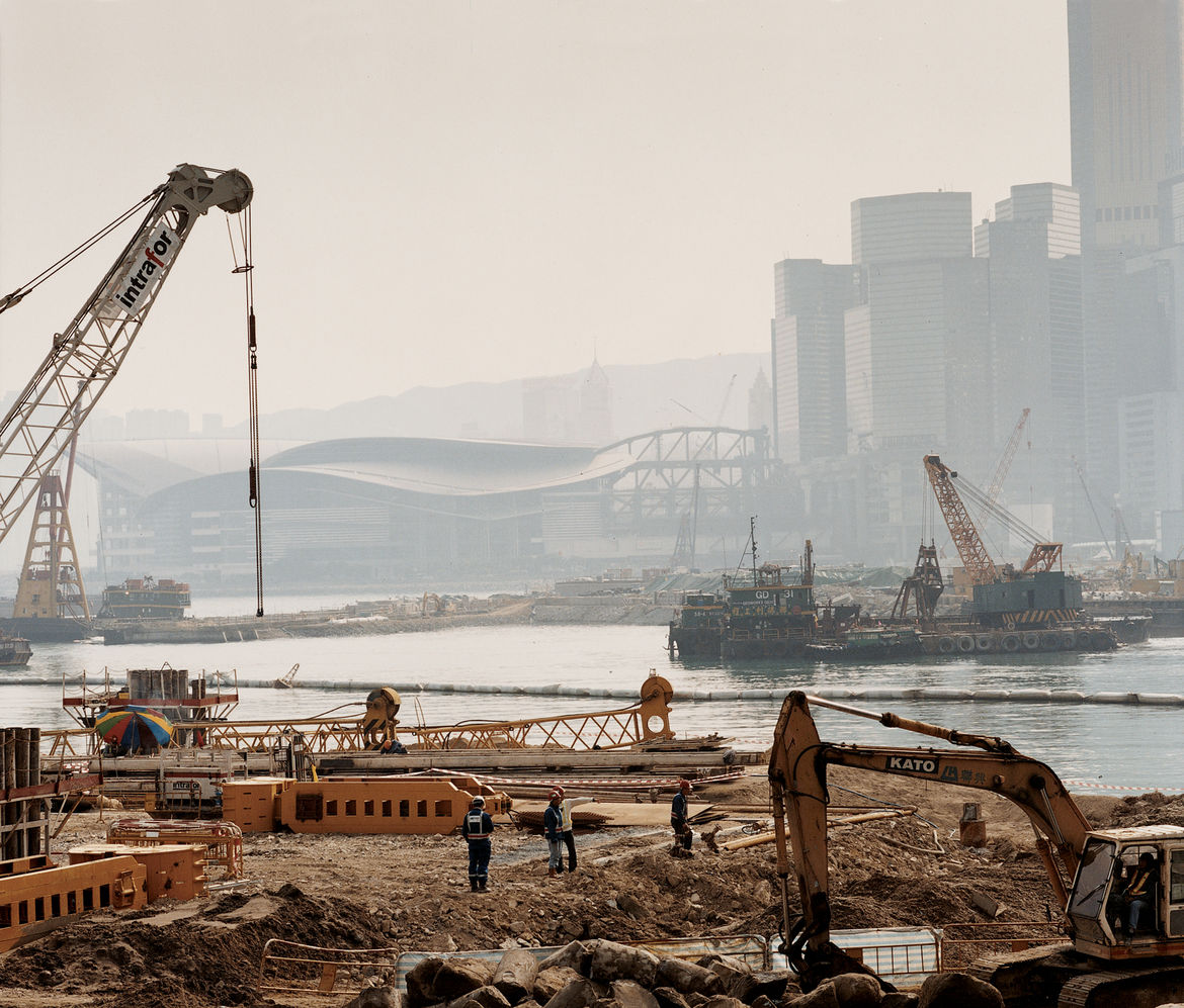 Workers survey the harbor-reclamation efforts.