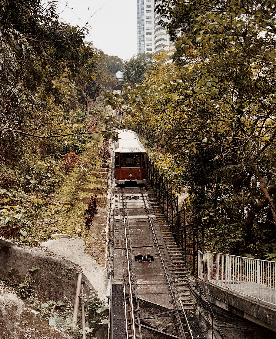 In operation since 1888, the Peak Tram conveys visitors to Victoria Peak, atop Hong Kong Island, in about ten minutes.
