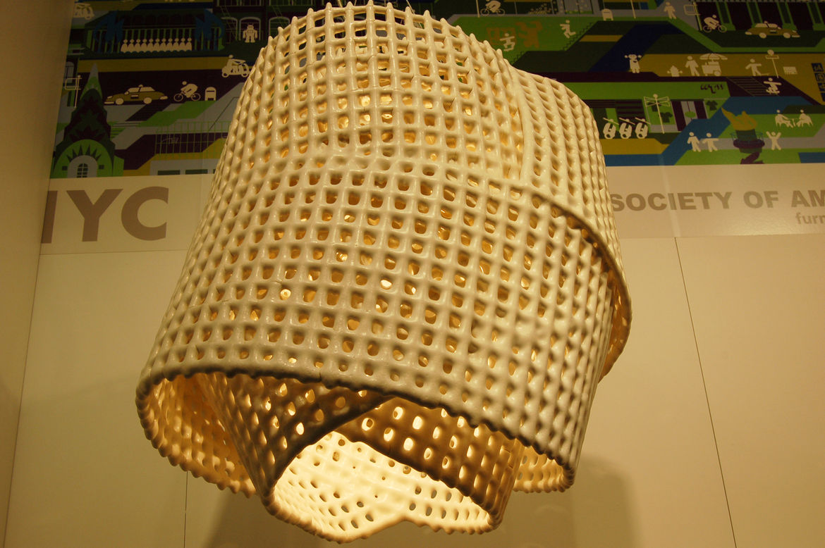 """It took several years for Brooklyn designer <a href=""""http://scottdanieldesign.com/index2.php#/home/"""">Scott Strickstein</a> to perfect the process of creating his ceramic light fixtures, called C Mesh. This one weighs about forty lbs."""