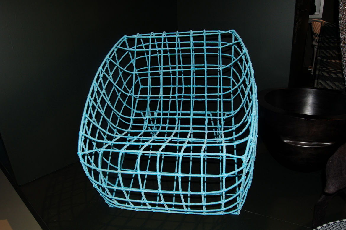 """At <a href=""""http://www.amaridianusa.com/"""">Amaridian</a>'s booth, a turquoise nylon-cord chair created by Malian designer Cheick Diallo was on display."""