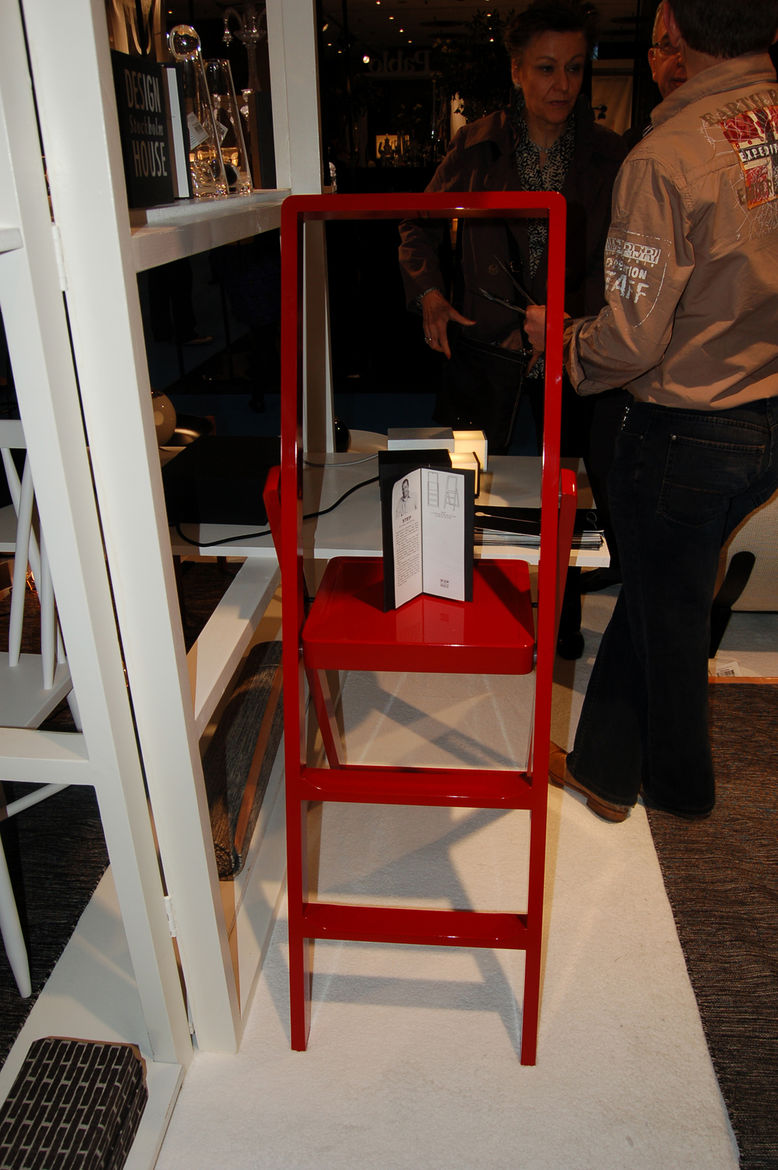 """At <a href=""""http://www.designhousestockholm.com/"""">Design House Stockholm</a>'s booth, industrial designer Karl Malmvall's Step ladder—which folds up into an impressively diminutive two inches—was displayed in glossy black, white and red."""