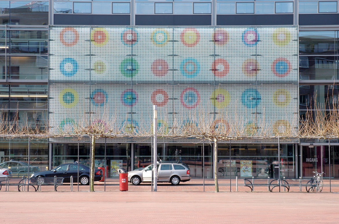 Martens's iconic targets punctuating the exterior panel of the Amstelveen Cultural Center.