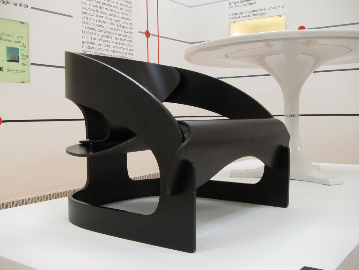 """A young Milanese architect named <a href=""""http://designmuseum.org/design/joe-colombo"""">Joe Colombo</a> realized the 4801 armchair in 1964. An anomaly in the catalog, the chair is made entirely from wood without the use of screws or glue."""