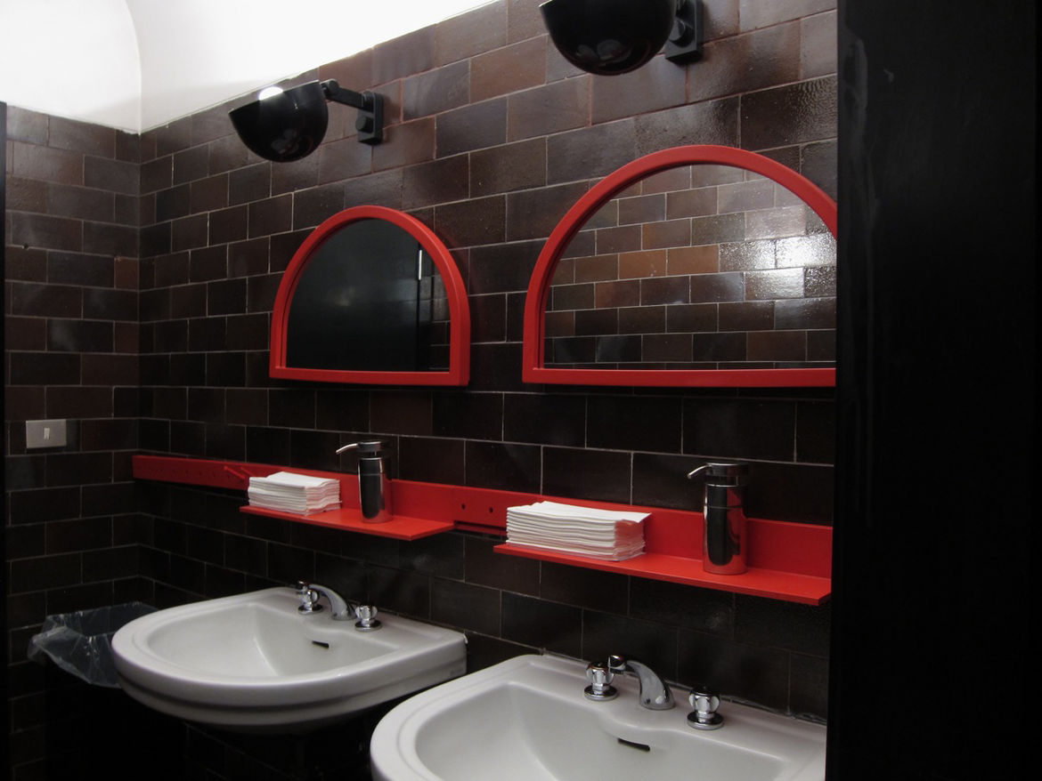 """The museum's bathroom is kitted out with Castelli Ferrieri's 5021/64 Outline System, the 1978 modular wall organizer based on shaker pegs.<br /><br />Don't miss a word of Dwell! Download our <a href=""""http://itunes.apple.com/us/app/dwell/id411793747?mt=8"""">"""