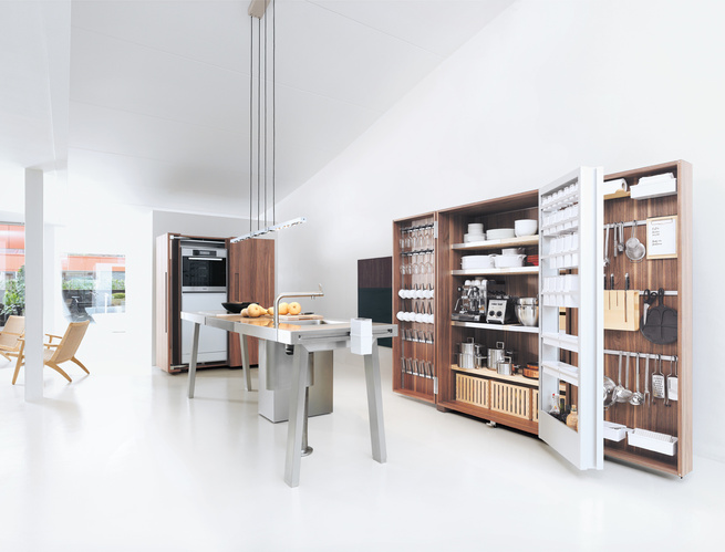 The Bulthaup b2 brings the woodshop into the kitchen with utilitarian workspaces and pristine, orderly wooden cabinet systems.