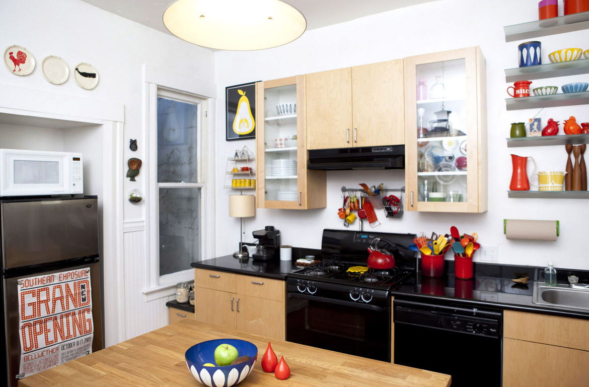 The island gets a lot of action. Pots and pans are stored below on one side, seating is lined up on the other, and food prep and art projects all congregate in the center of the kitchen.
