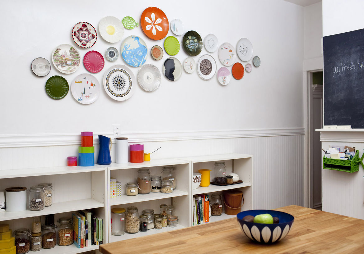 A few functional changes have helped make the most of the available space in the kitchen. Congdon and Walsh installed a shelving unit underneath the plate wall last year, which gave them a handy place to store their dry goods and cookbooks.