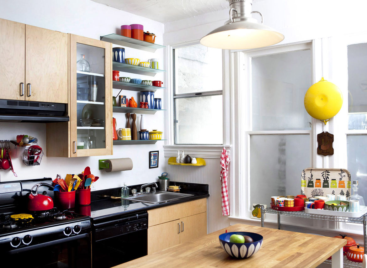 Installing an IKEA island helped the kitchen become far more than a functional room for food preparation. The windows provide some of the best natural light in the house so oftentimes, Congdon will clear the fruit bowl away and use it as a workspace for s