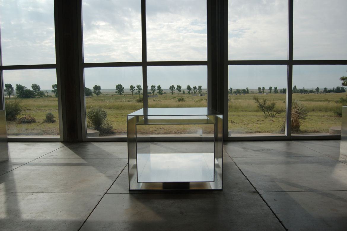 The aluminum pieces are the center of Judd's collection. It took four years to install them all to Judd's famously exacting standards. Judd's poured-concrete structures are in the distance, situated next to a scrim of cottonwoods that Judd planted to form