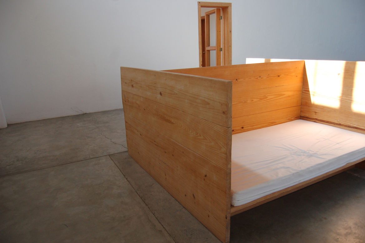 Judd designed this piece, which is a bed separated into two sleeping areas by a central plane of wood, for his two young children. It's reminiscent of the two-sided bed Frank Lloyd Wright used to nap in at Taliesin West—one side for lounging, and one side