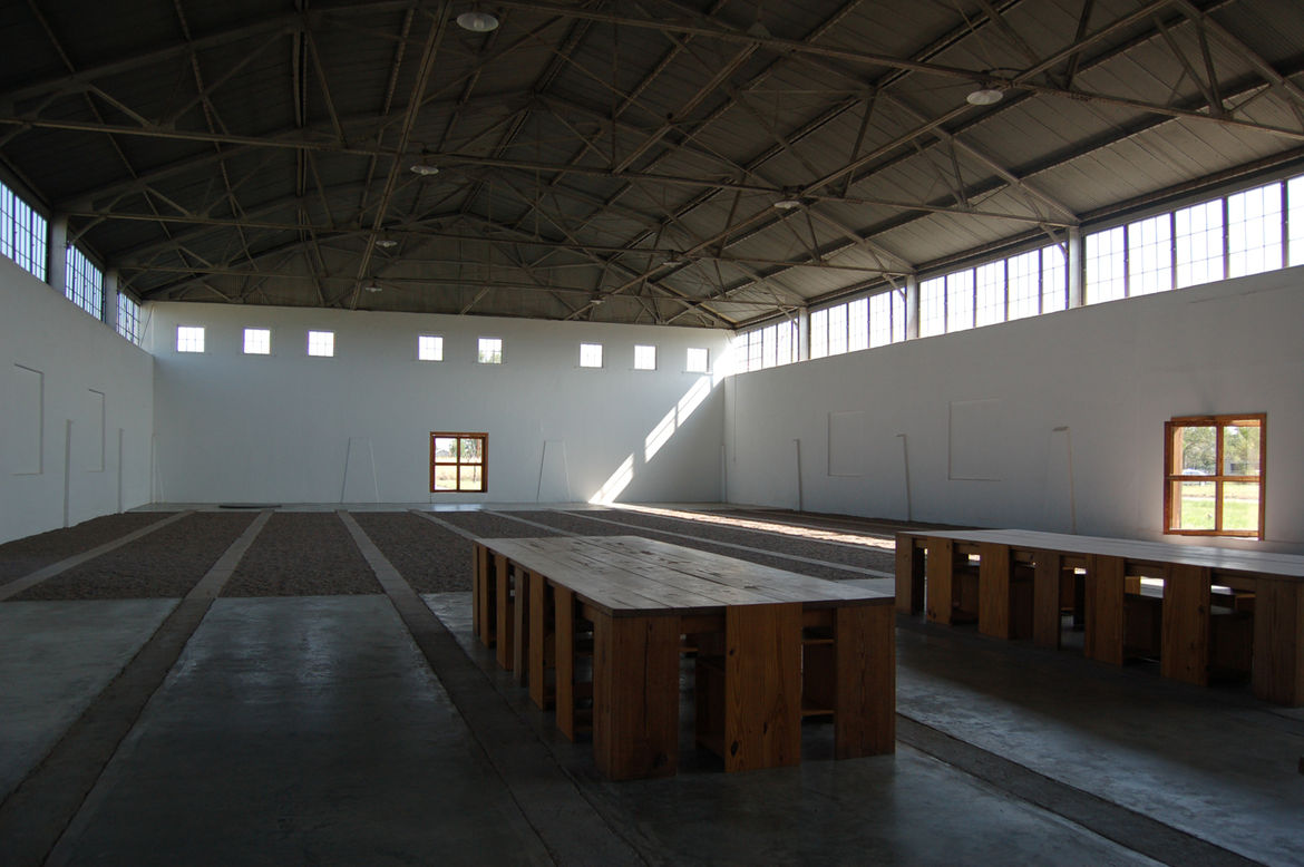 Judd restored the building in the 1980s—it had fallen into disrepair after years of serving as horse quarters. The Chinati Foundation often hosts parties here, and guests dine at the Judd–designed tables and chairs.