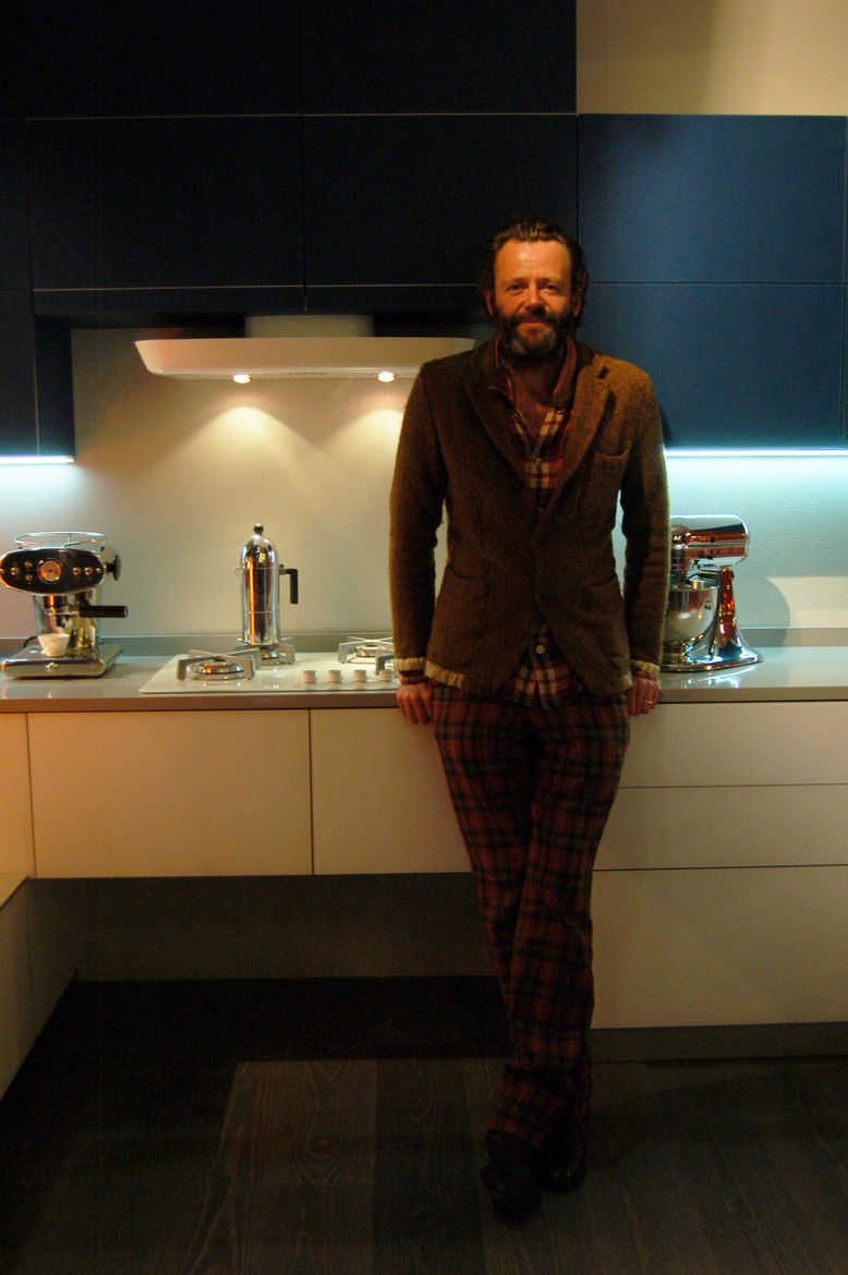 "Hong Kong–based industrial designer <a href=""http://www.michael-young.com/"">Michael Young</a> poses in front of Tetrix, his new modular kitchen concept for <a href=""http://www.scavolini.com/"">Scavolini</a>. The system is made entirely of rectangular compo"