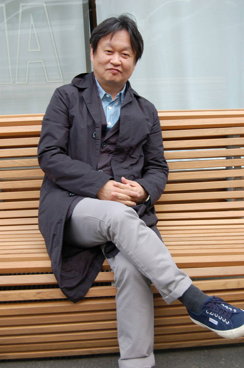 Naoto Fukasawa takes his turn posing on his Titikaka bench, which features undulating teak slats and an aluminum frame. In conversation with Sam Grawe, the designer said the sinuous form, as well as the name, was inspired by the traditional straw boats of