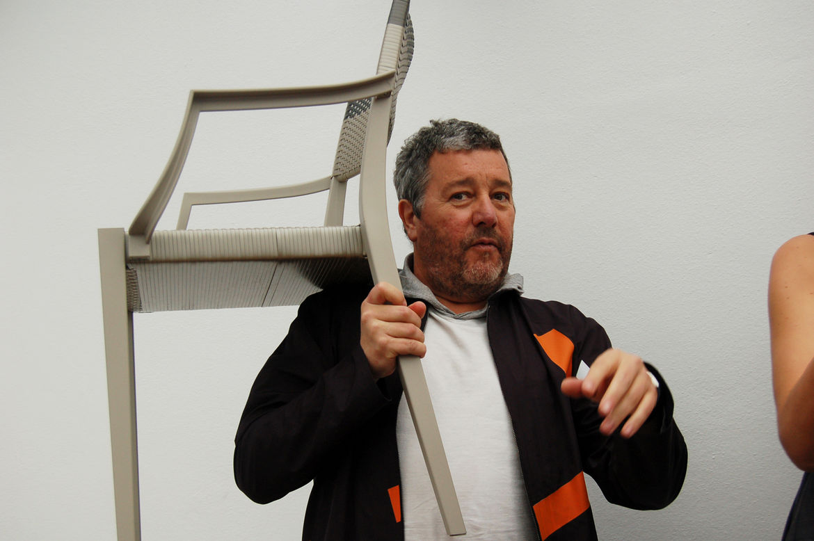 """Starck demonstrates the lightweight heft of his new outdoor chairs for <a href=http://www.dedon.de/en/home.html"""">Dedon</a>. Look for Sam's interview with him soon."""