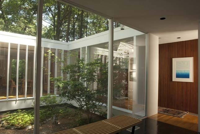 An interior view of the Flansburgh House, located in Lincoln, Massachusetts. Lincoln became a popular destination for the American Modern movement thanks to Walter Gropius, who founded the Bauhaus School of Architecture in Germany before emigrating to Mas