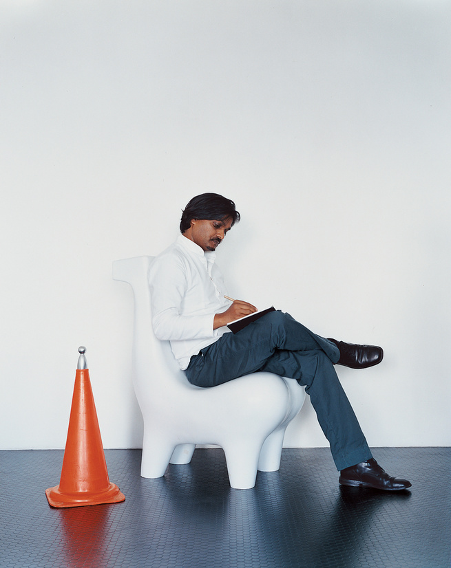 The designer is pictured here on a prototype of his Horse chair, a design that has become iconic for him. Eminently suited for a wide variety of settings, the seat has been executed in materials using bell metal and Corian.