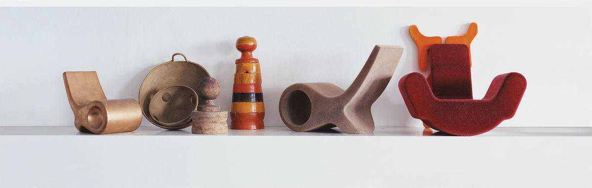 A lineup of Pakhalé's working models, including two prototype versions of the Fish chair, designed for Cappellini. The simple forms are used to dramatic effect when the materials vary, from Corian to bent glass.