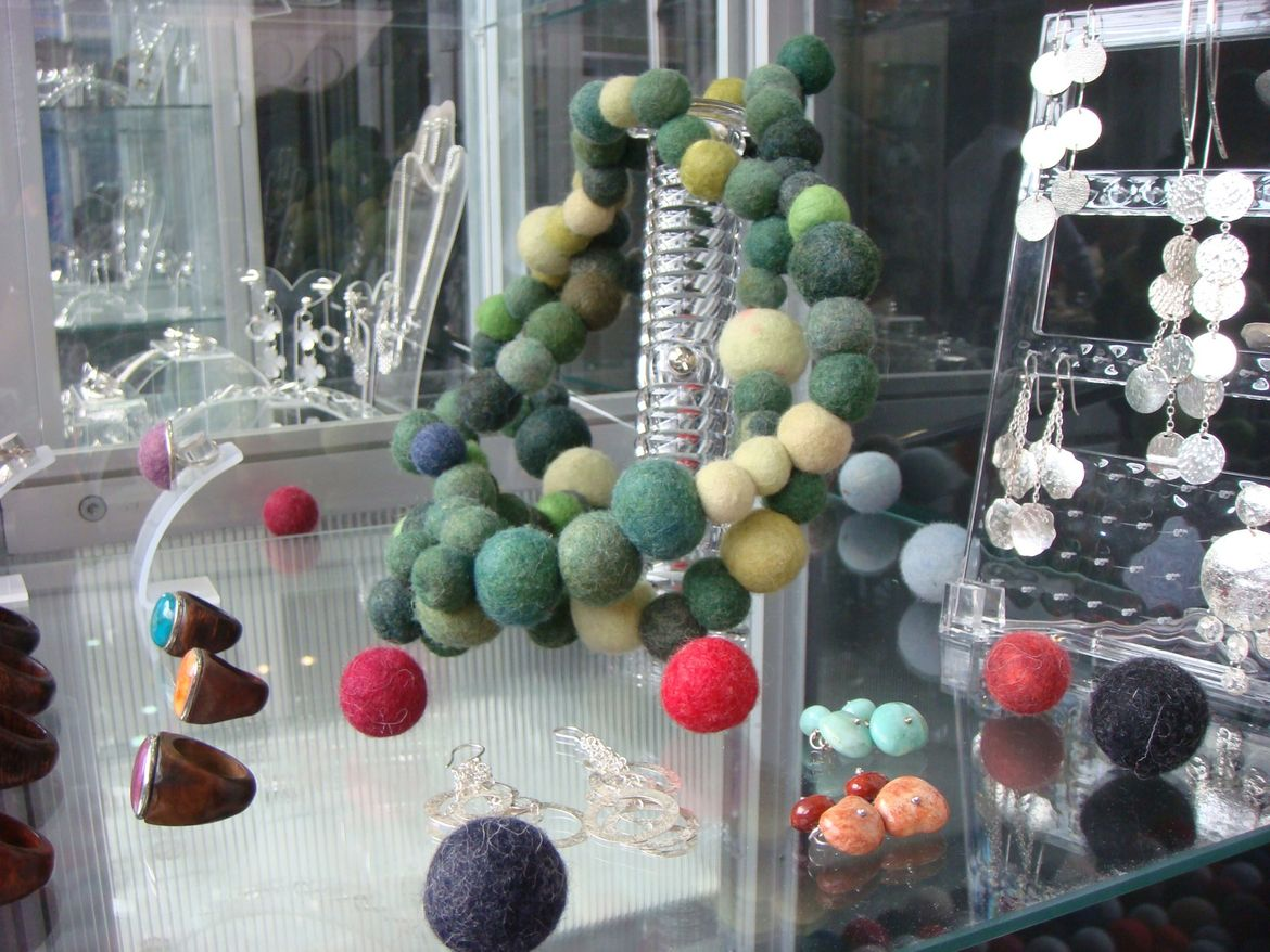 "A felt bauble necklace, chunky wooden rings, and scintillating silver earrings by <a href=""http://joyascontemporaneas.com/"">Mariana Sanz</a>."