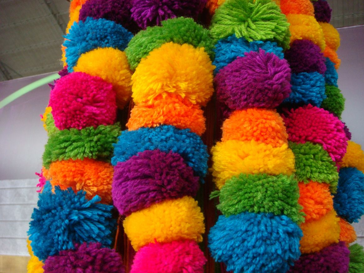 Colorful pompoms in all the vibrant colors found throughout the fair.