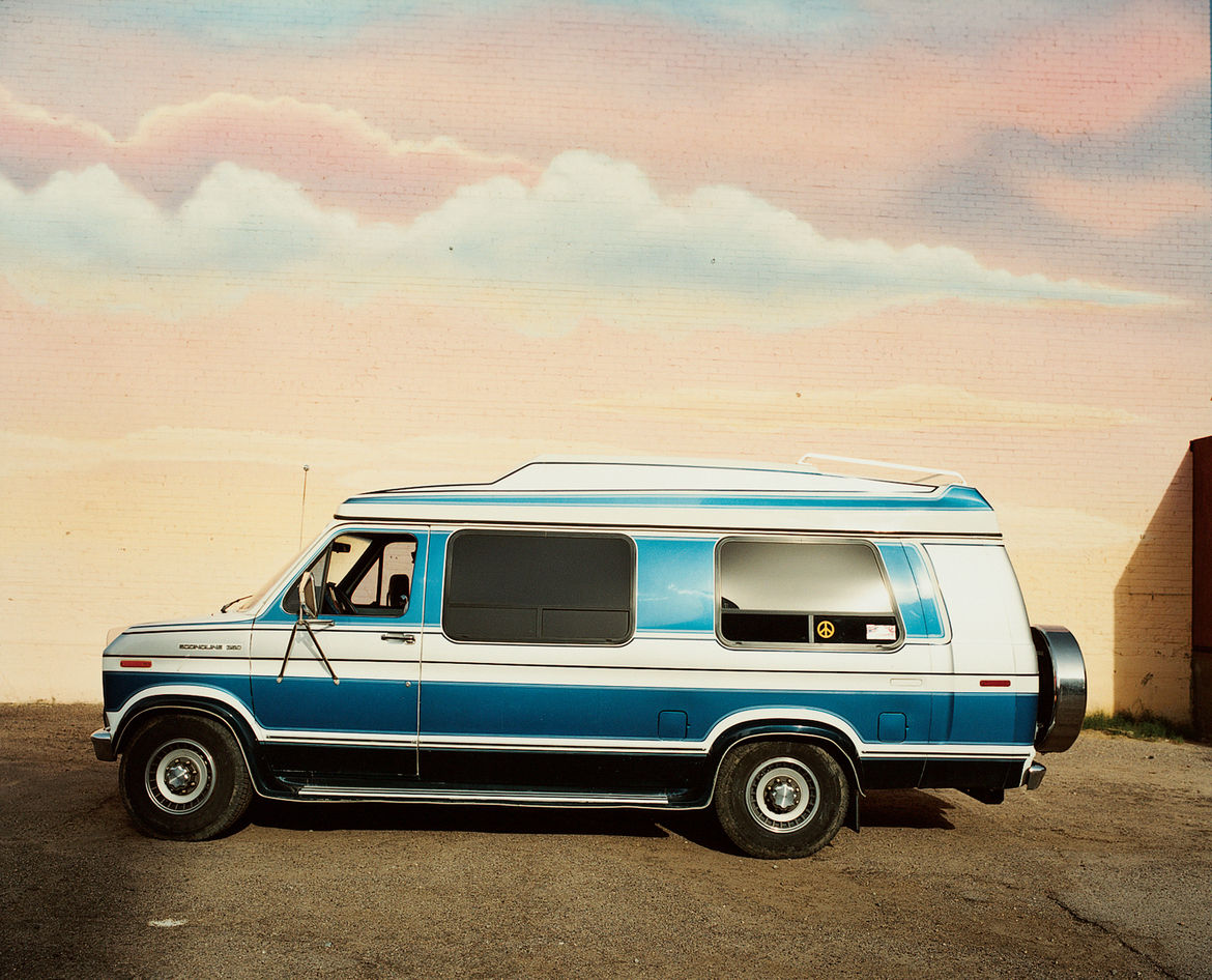 A mural provides the perfect backdrop for this van parked at the Icehouse, a historic space now home to art installations and community events.