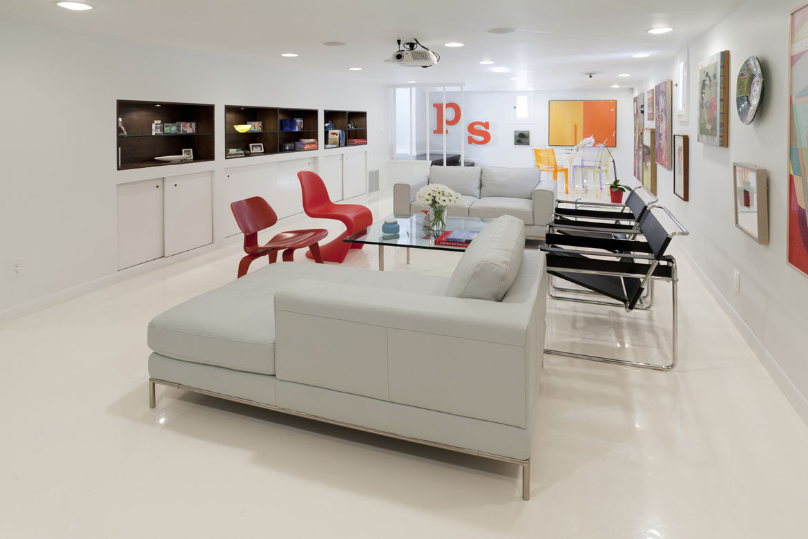 """The open media room. Joining the Panton and Eames chairs are leather-and-chrome Breuer chairs, a Mies Barcelona table and a chaise and loveseat from IKEA. Photo by <a href=""""http://mikegraffigna.com/"""">Mike Graffigna</a>"""