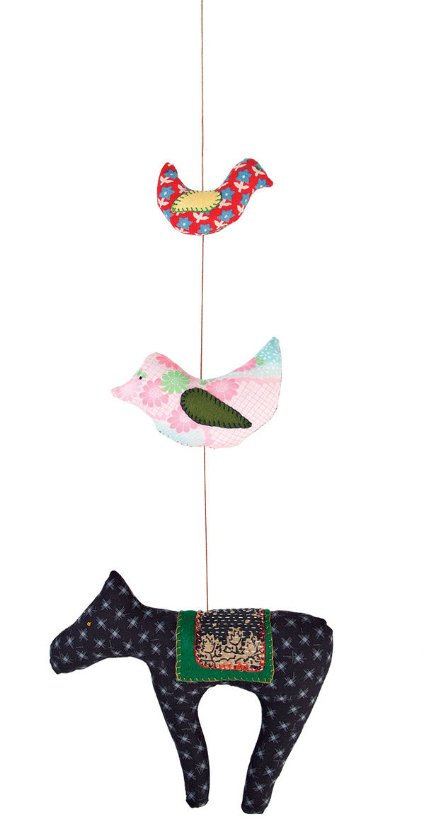"""A textile mobile from <a href=""""http://www.reformschoolrules.com/pc/hsmobile/homeec/Hillery+Sproatt+Mobile"""">Hillery Sproatt</a>."""