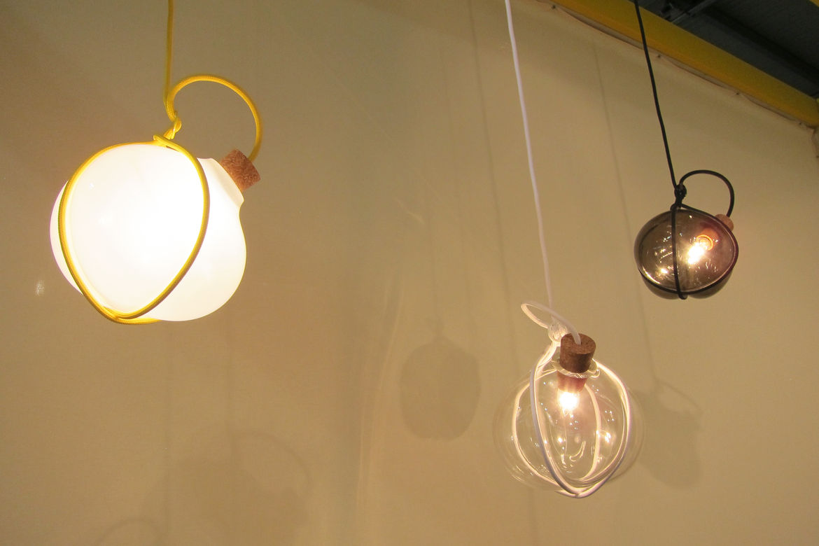 "Swedish designer <a href=""http://www.lukasdahlen.se/products/gable/"">Lukas Dahlén</a> presented several items, including his Gable pendant series. The blown-glass-and-cork pieces hang from a cloth cable, presenting the illusion that the softness of the gl"