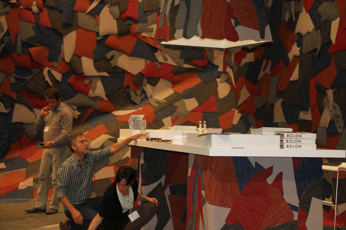 "The <a href=""http://www.campanas.com.br/"">brothers Campana</a> attend to the finishing touches of the <a href=""http://www.bolon.com/"">Bolon</a> booth. The Stockholm–based company, which manufactures woven vinyl products, enlisted the designers to collabor"