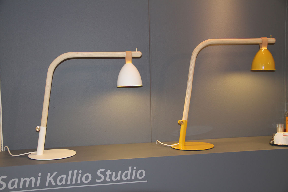 """We end with another student work—Workshop by Finnish designer  <a href=""""http://cargocollective.com/SamiKallioStudio"""">Sami Kallio</a>. The lamp is of seemingly simple construction, with an aluminum shade that moves along the bent-ash body by way of a strai"""