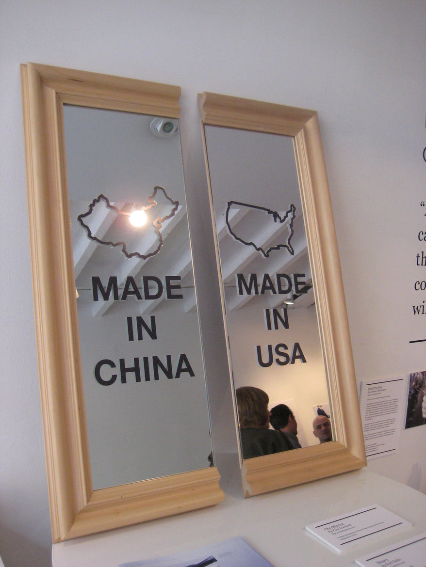 """Chi-Merica by <a href=""""http://paulloebach.com"""">Paul Loebach</a>. This mirror represents the divide between American-made products and those produced in China."""