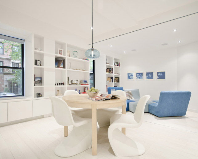 """Opposite the kitchen is a dining area and living room, which can be partitioned off with a set of folding doors. The dining table is from Ikea and the chandelier is from <a href=""""http://www.nichemodern.com/AURORA-MODERN-PENDANT-LIGHT.html?Category_Code=Mo"""