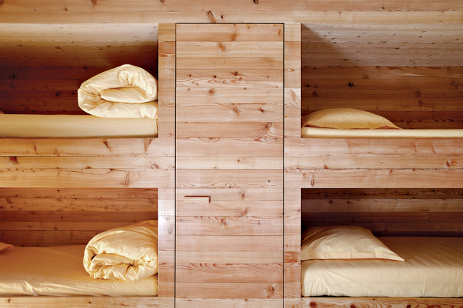 "The entire Wooden Cabin—including the sleeping cubbies, shown here—is clad in locally sourced larch, which over time will turn gray then black. <a href=""http://www.dwell.com/articles/first-class-cabins.html"">Read the full story here.</a>"