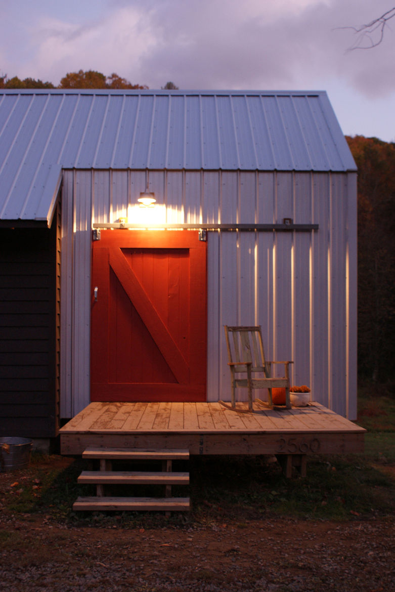 The red barn door on a sliding track door is an icon, built from salvaged pine from the original farmhouse.